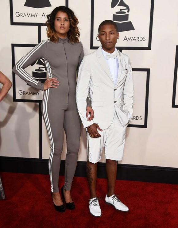 Pharrell Williams y Helen Lasichanh en los Grammy 2015 a punto de salir a hacer running