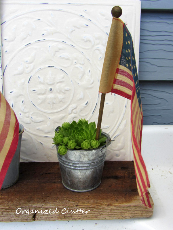 Flags in Outdoor Pots www.organizedclutterqueen.blogspot.com