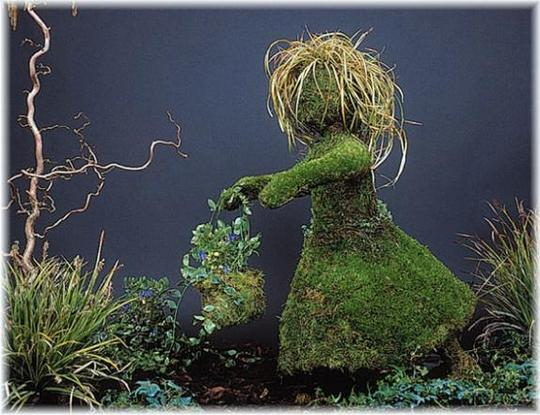 Different Types Of Plants Create Different Effects In A Topiary Design. In  This Design Of A Little Girl Running, The Girlu0027s Hair Has Been Created With  A ...