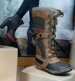 Sorel knee high duck boots.
