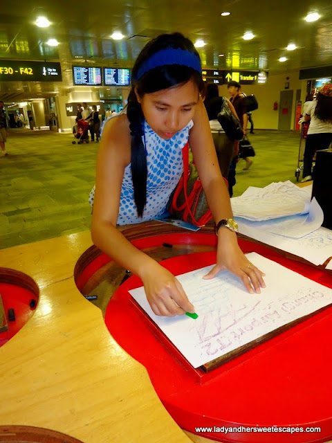 make a piece of art in Changi Airport Singapore