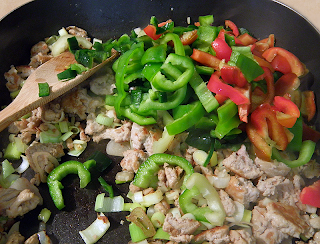 Pile of Multicolored Peppers added to Pan with Meat and Onion