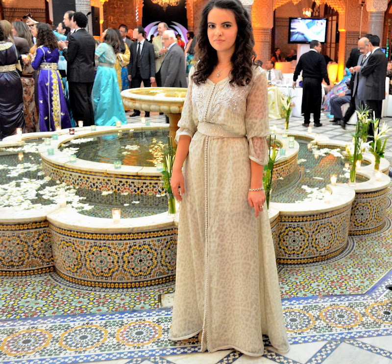 white moroccan caftan on wedding venue