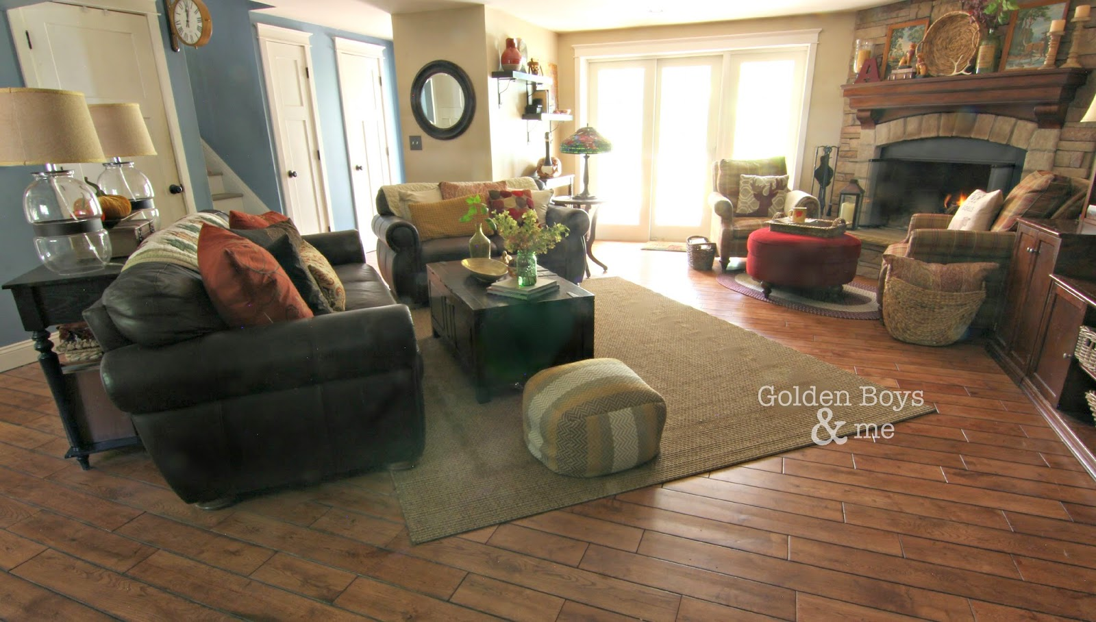 Family room with corner stone fireplace and leather furniture-www.goldenboysandme.com