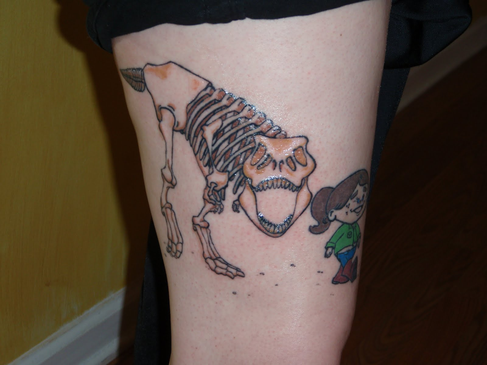 Funny And Strange Tattoos With Dinosaurs