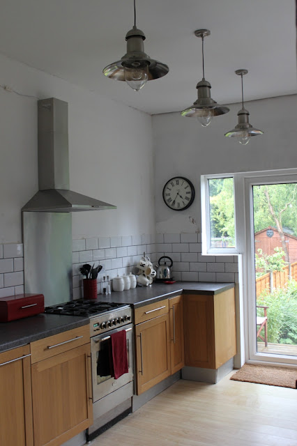 Progress Report White Brick Tiles And Shiny Cooker Hoods