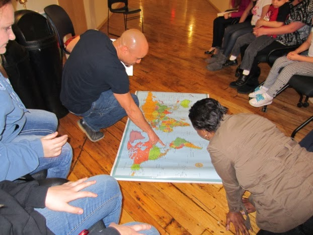 Participants in NeighborCircles show others on a world map the origins of their families.