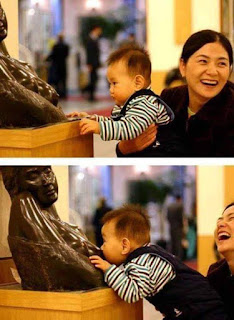 Cute naughty Boy with statue