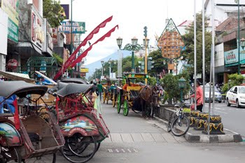 Becak and Andong, the two common means of traditional transportation in Yogyakarta