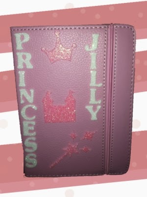 Jillyn's pink, glittery, customized Kindle.