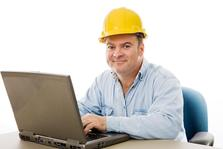 Picture of a construction worker taking an OSHA 10 hour class on his laptop.