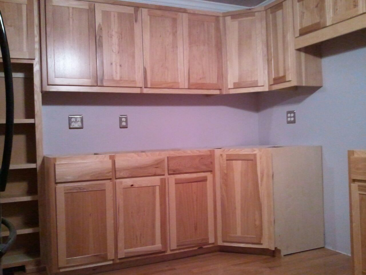 Set of Calico Hickory cabinets. Shaker style doors with clear finish.