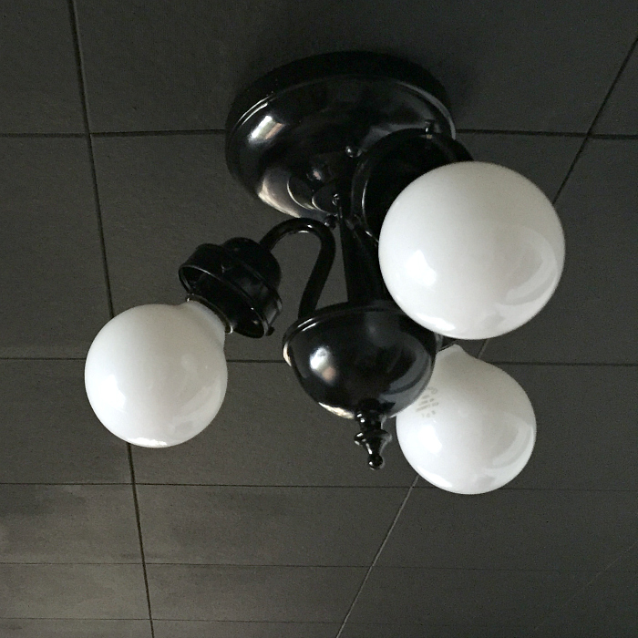 ceiling tile painted black, vintage light fixture