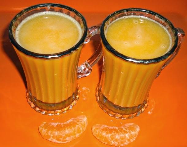 Orange  or santra Juice in serving glasses