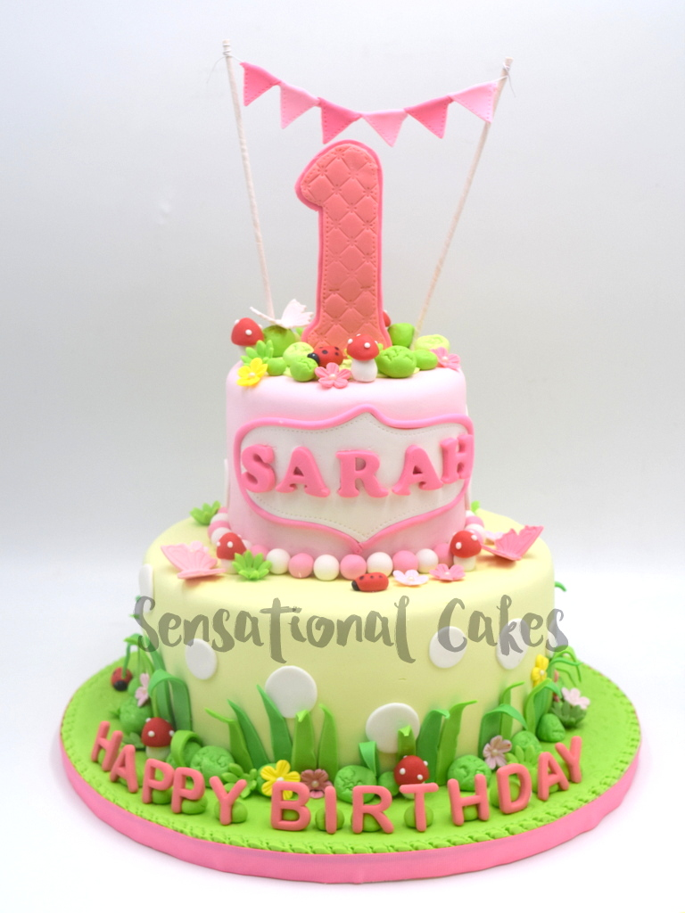 The Sensational Cakes Pink Color 1st Year Birthday In Garden Theme