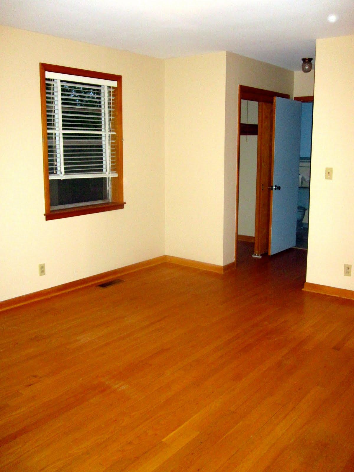 tan walls brown floors brown baseboards brown window trim and yes