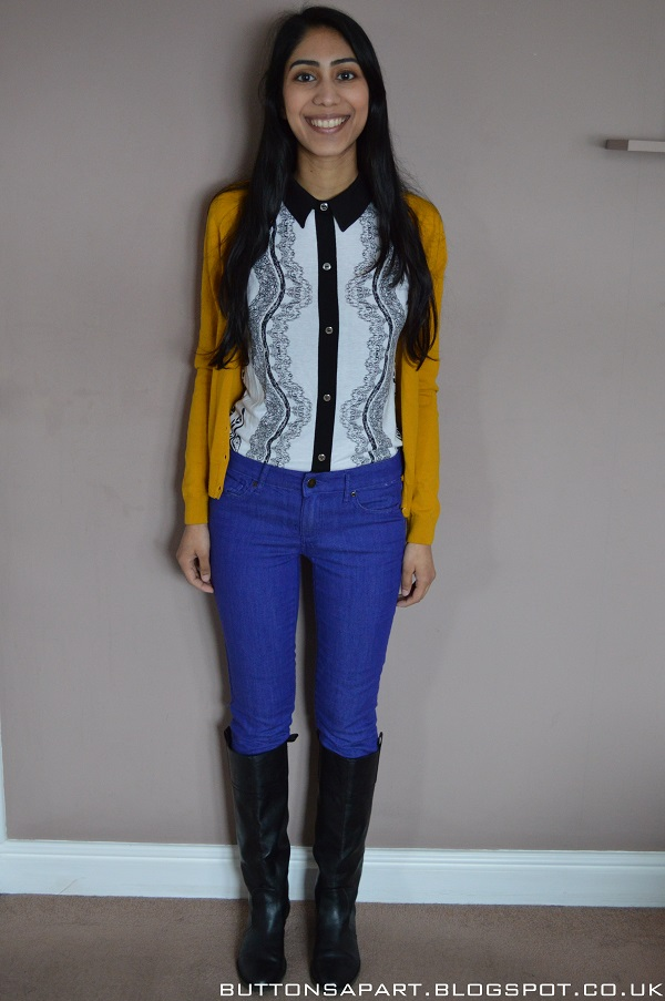 An outfit picture featuring cobalt blue jeans, a printed top and mustard cardigan.