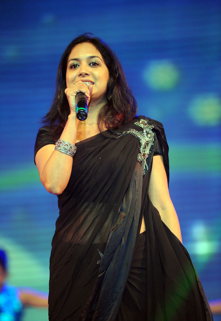 singer sunitha latest hot navel show in black transparent saree