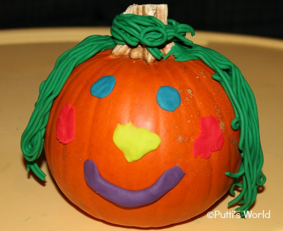 Kids Decorate Pumpkins With Play Doh