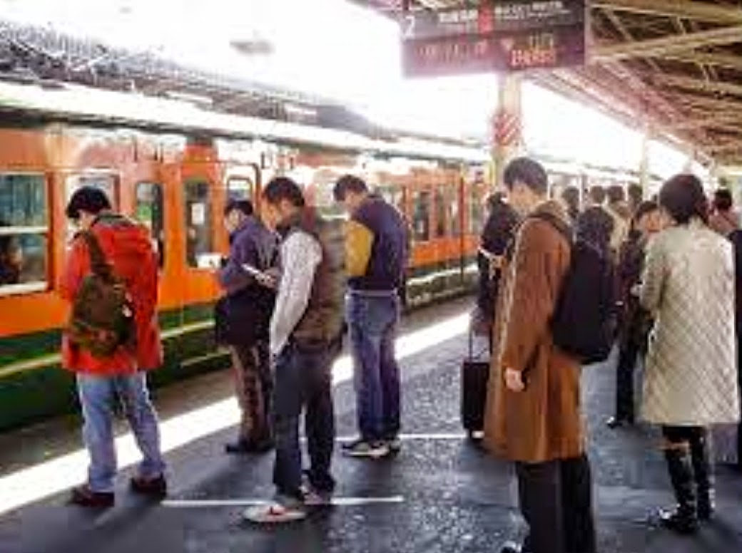 Japanese commuters with phones