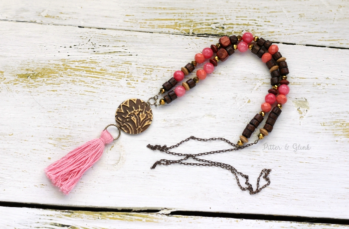 Embossed Metal & Bead Tassel Necklace. www.pitterandglink.com