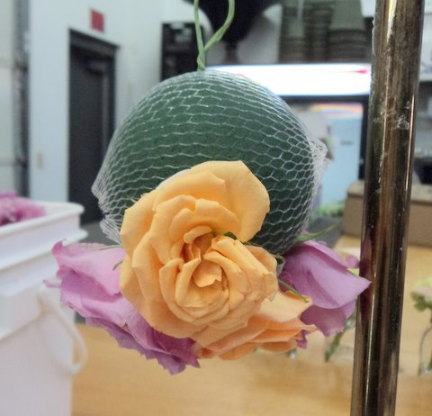 Here I have begun to insert the flowers into the Oasis ball, through the ...