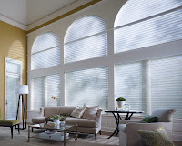 large windows with shades in a living room