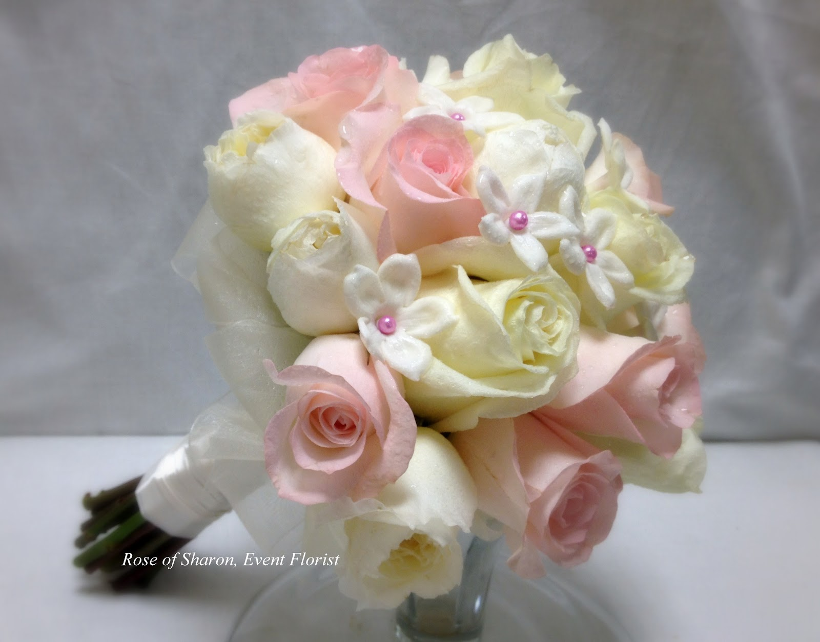 the brides beautiful bouquet was full of roses and stephanotis blooms - Garden Rose And Hydrangea Bouquet