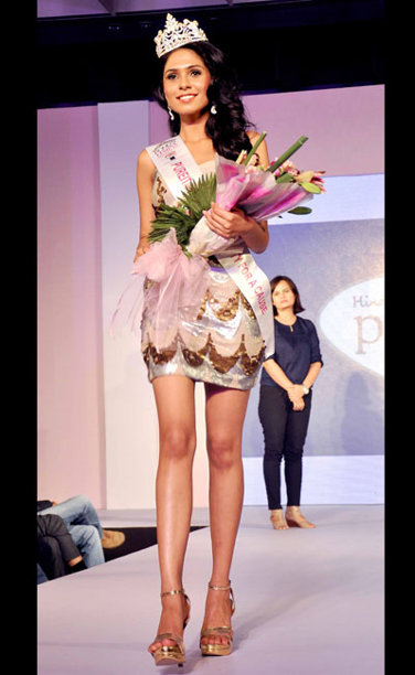 Radhika Sharma, winner of Sinhgad Institutes Femina Miss Intellectual and Pureit Femina Miss Beauty For A Cause 2013 Sub-Titles during the Ponds Femina Miss India 2013 beauty pageant held at Yash Raj Studios in Mumbai on March 24, 2013.