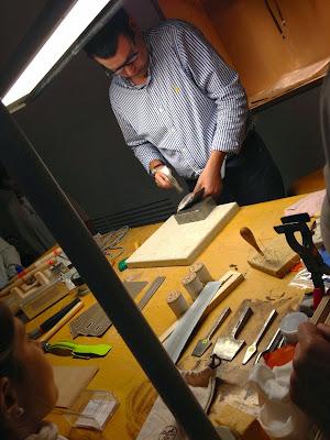 artisan crafting a bag