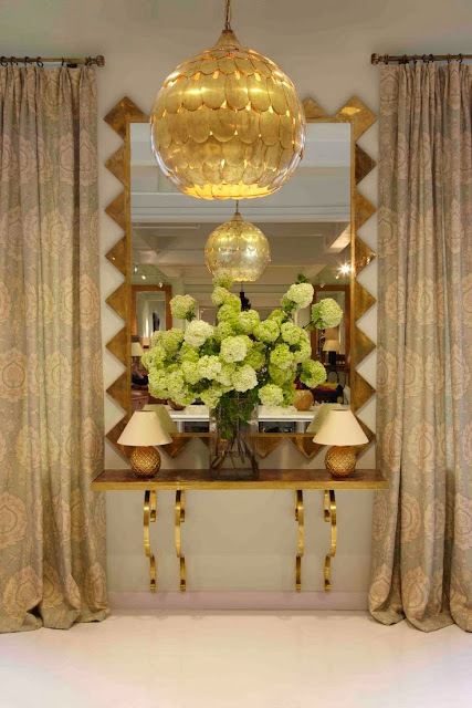 vignette styling console table gold accessories oversized mirror