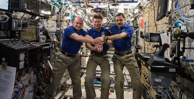 On July 15, 2015 aboard the International Space Station, Expedition 44 crew memebrs Scott Kelly of NASA (left), Expedition Commander and Russian cosmonaut Gennady Padalka (middle), and Russian cosmonaut Mikhail Kornienko (right) commemorated the 40th anniversary of the joint Apollo-Soyuz mission. Credit: NASA