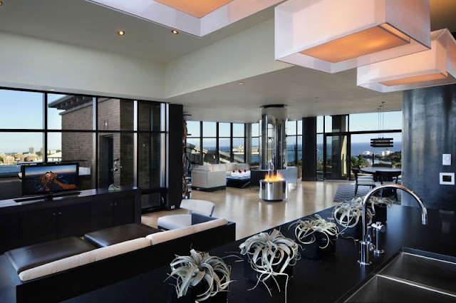 Picture of modern black and white penthouse interior as seen from the kitchen