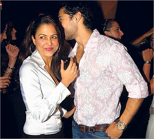 Dino Morea and Amrita Arora laughing