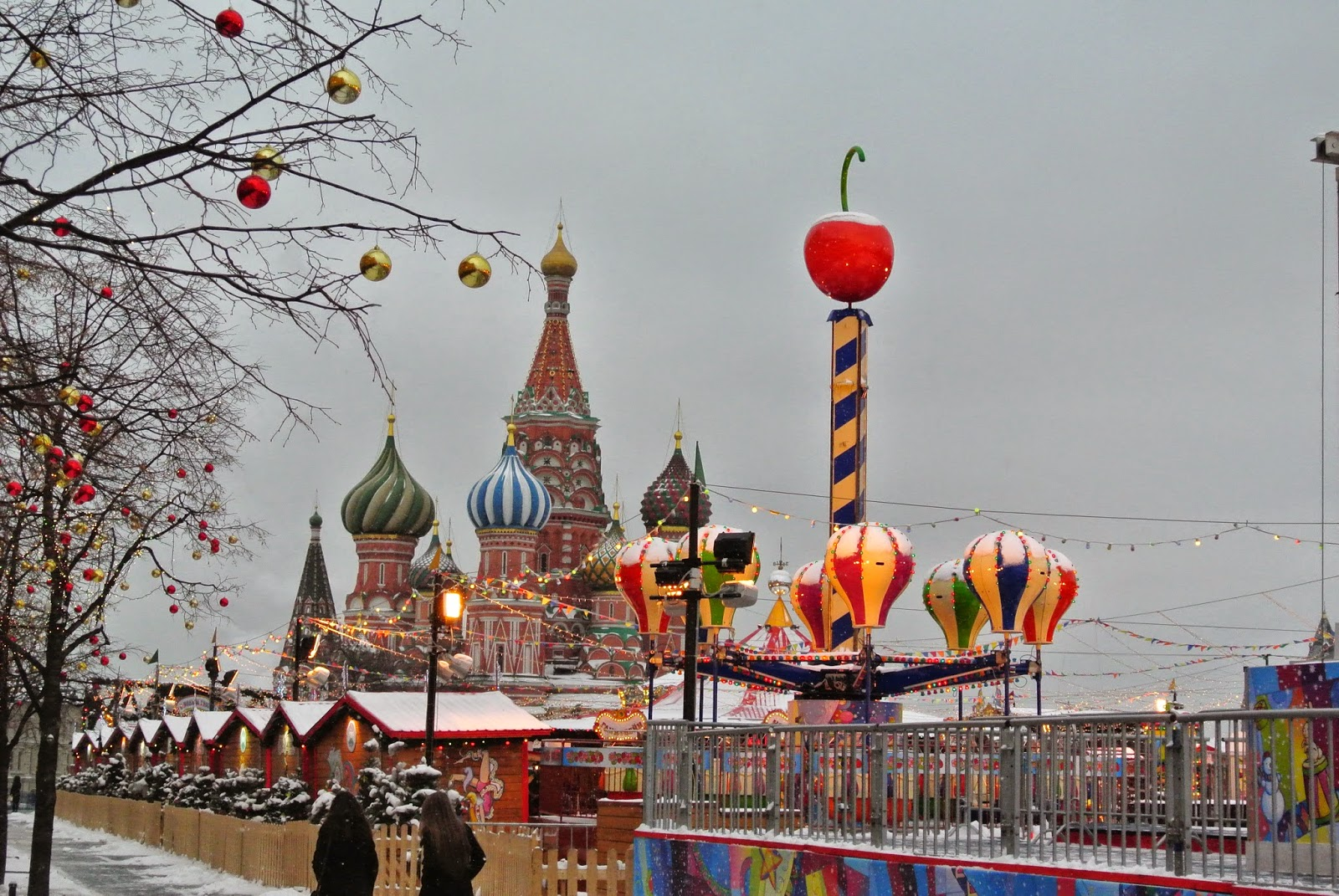 St Basil's cathedral and a merry-go-round at the Christmas marker, Red Square, Moscow