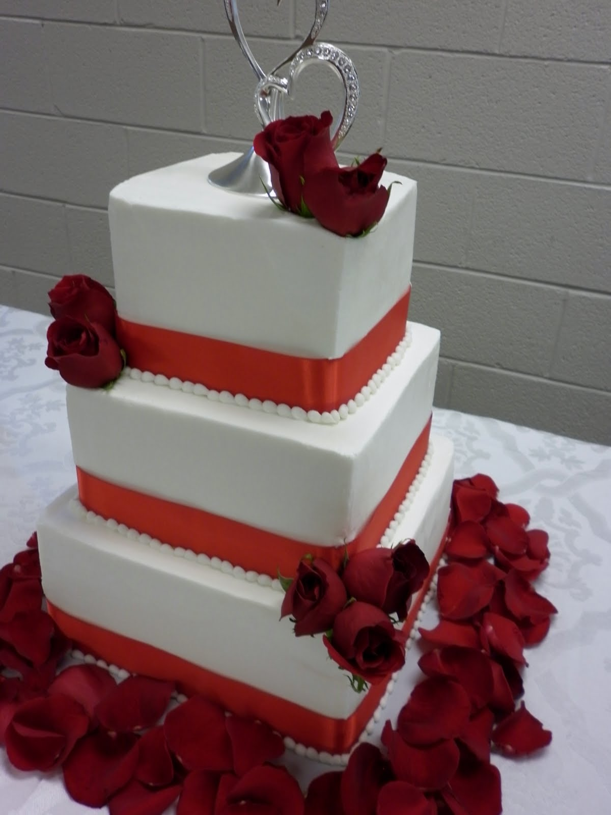 Tis So Sweet Cakes Wedding cake with Red Ribbon