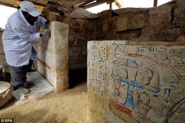 The tomb, pictured, is of open courtyard style and can be dated back to the end of the Ramesside period, which is named after the eleven kings with the name Ramesses, who ruled in the Nineteenth to the Twentieth Dynasties. Here, a man works on a wall inside the tomb of the head of the army archives