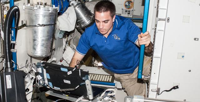 NASA astronaut Chris Cassidy, Expedition 36 flight engineer, enters data in a computer in the Tranquility node of the International Space Station. Image Credit: NASA