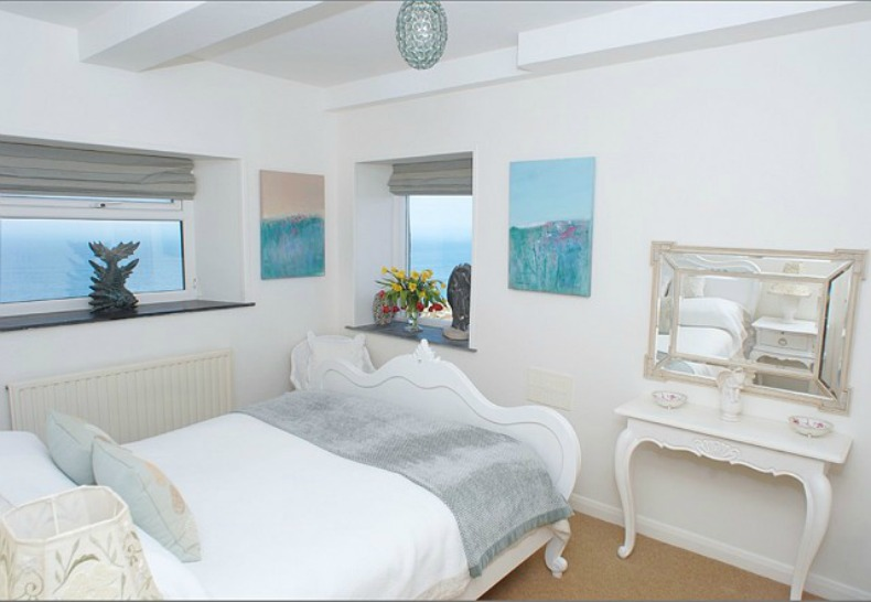 beach house guest bedroom with a view