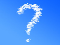 A cloud in the shape of a question mark on a clear, blue sky