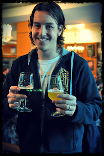 image of blogger with the doctors Orders Plasma White IPA and Mountain Goat/Mikkeller collaboration, Gypsy and the Goat Pepperberry Black IPA in each hand