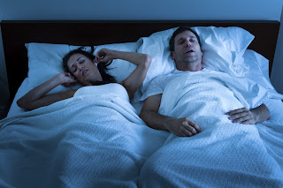 snoring man and tired wife