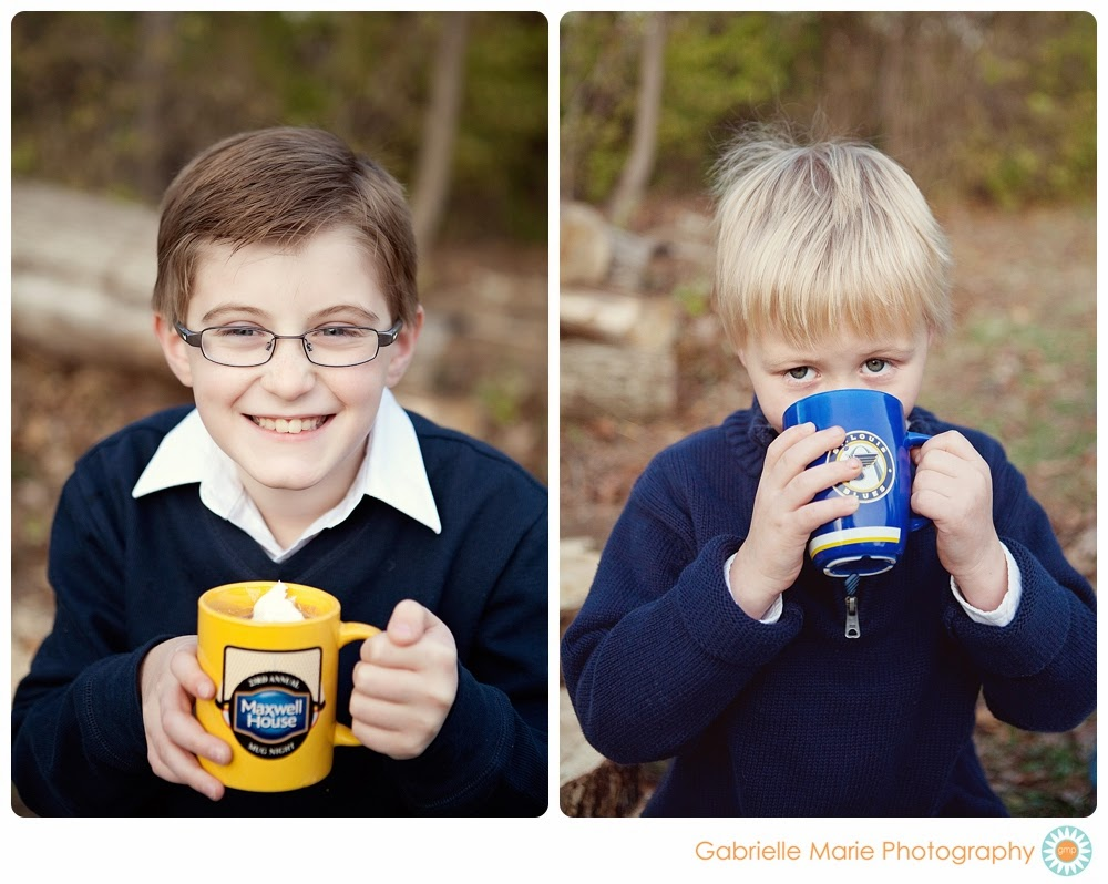 Two brothers in blue sweaters sipping hot chocolate