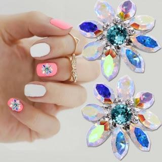 http://www.bijuteriifrumoase.ro/cumpara/crystals-for-nails-navette-flower-u06-10mm-1405