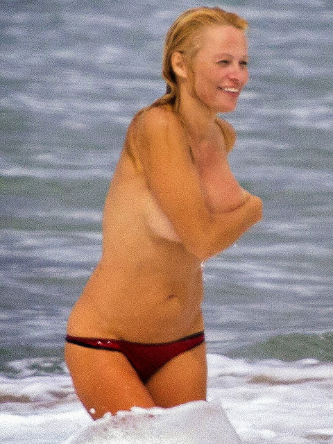 Pamela Anderson Topless Bikini Candid Photos On A Beach In France