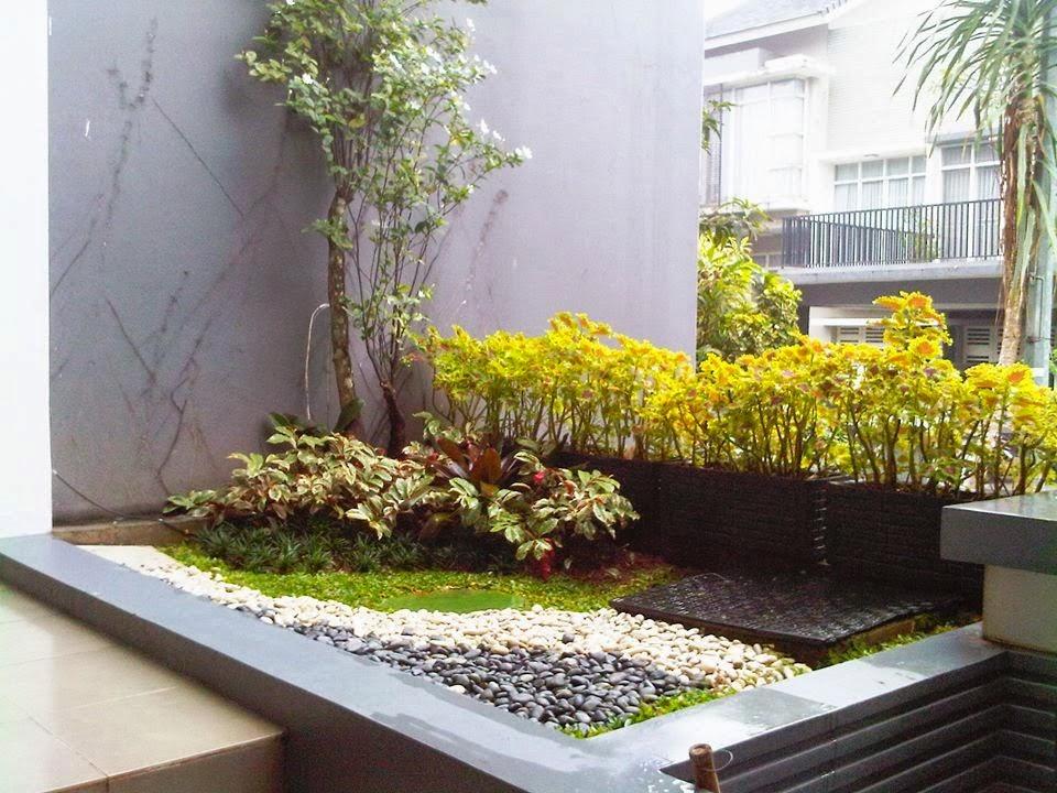 Model Taman kering Batu Koral Depan Rumah Minimalis