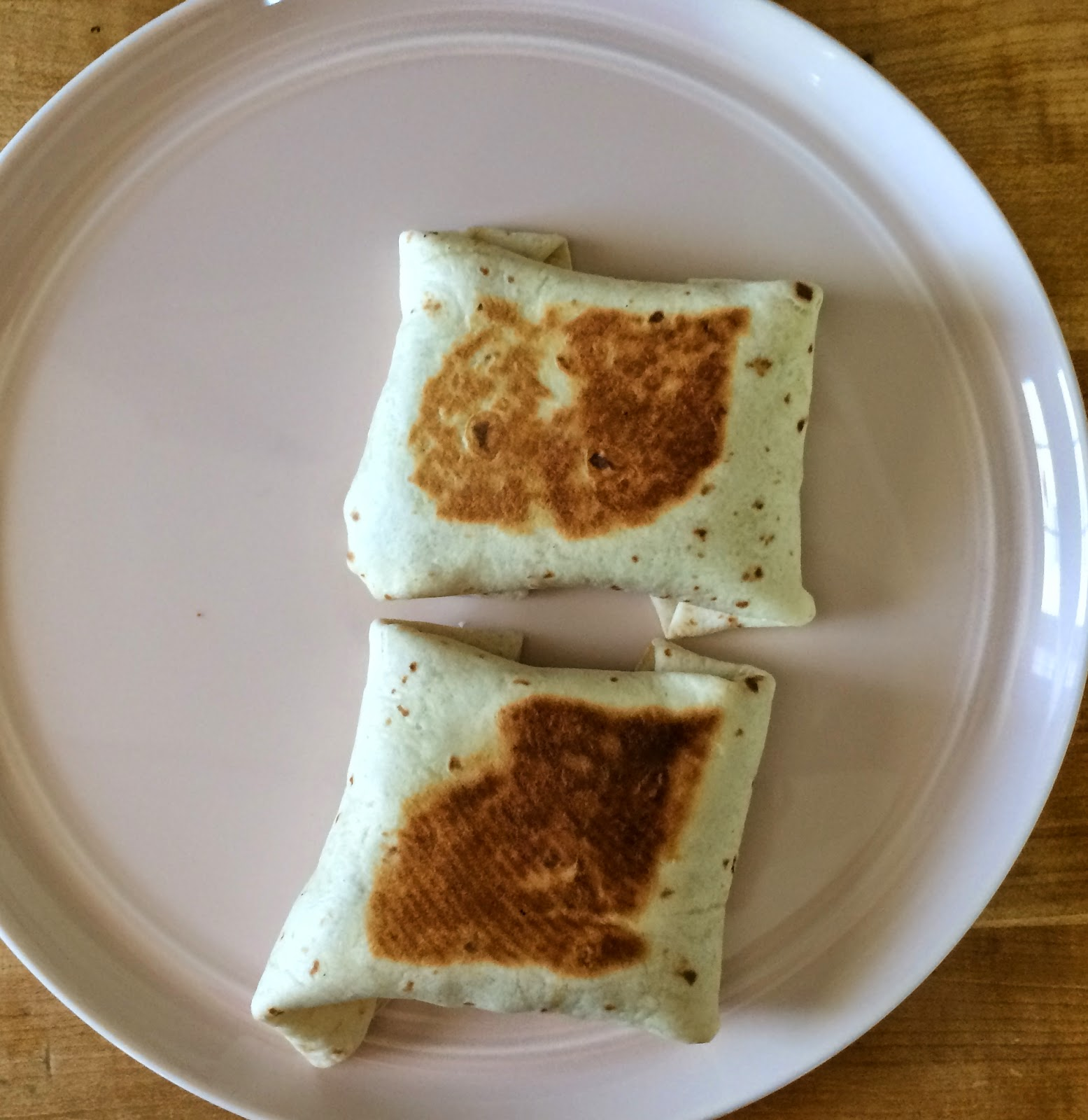The perfect easy bean burritos with a cheesy pocket! The Graffitied Gardenia.