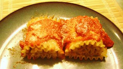 Pumpkin Lasagna Rolls garnish with Parmesan