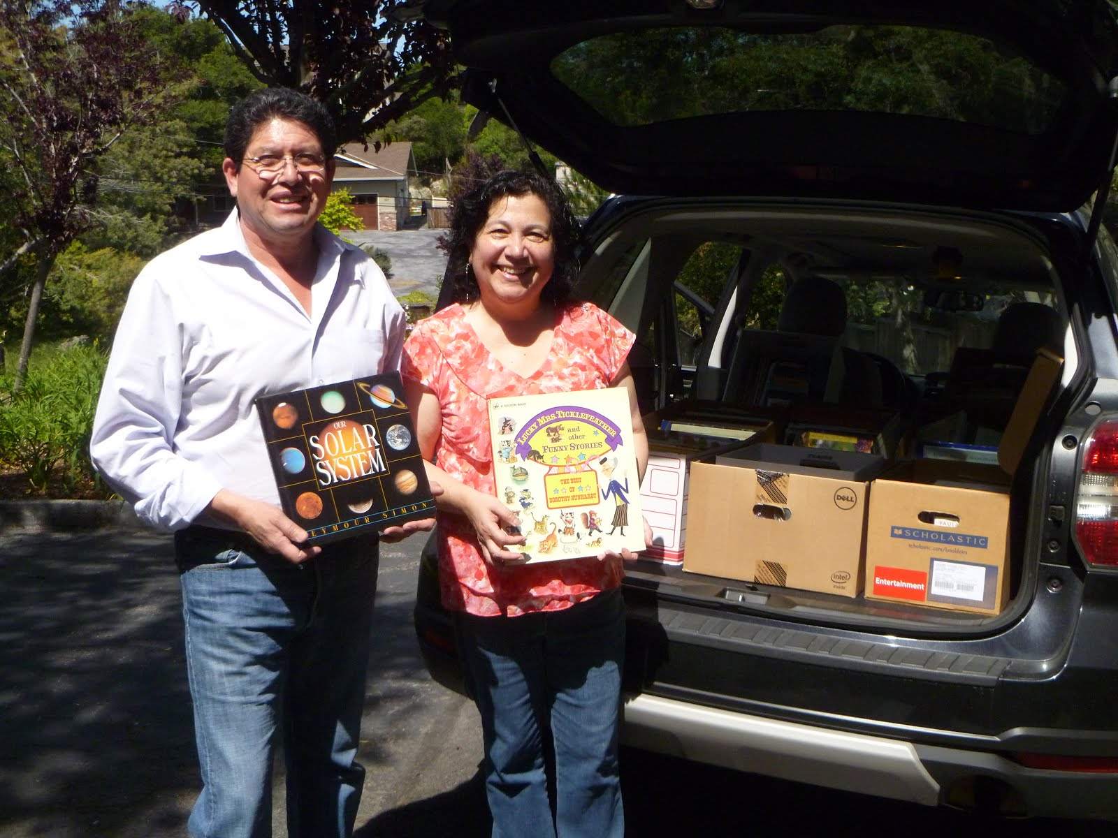 Making an Impact on Literacy by donating 8 boxes full of books to Familias Unidas