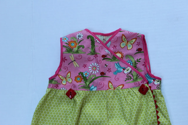 finishing armholes, sewing buttons